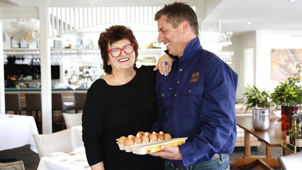 Farmer's dozen: Alla Wolf-Tasker with farmer Paul Righetti, owner of Real Eggs, who supplies eggs to Lake House. Picture: Chloe Smith